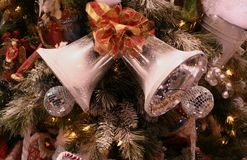 Silver Bells on Tree. Silver bells on Christmas tree Royalty Free Stock Photography