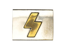 Silver belt buckle with a golden sign Stock Images