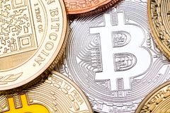 Silver bitcoin as a background and some coins. High resolution photo royalty free stock images