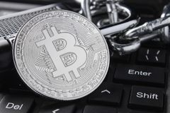 Silver bitcoin close-up. Electronic payments, blockchain technology. keyboard. stacking stock image
