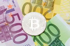 Silver Bitcoin close-up. Euro currency as a background. Macro ph. Oto.  High resolution photo Stock Images