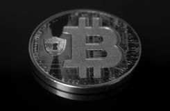 Silver bitcoin coin. On a black background stock photography