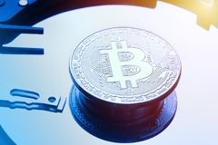 Silver bitcoin coin on HDD hard drive disk plate. Electronic money cryptocurrency symbol.  Royalty Free Stock Photos