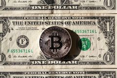 Silver bitcoin coin lying on United States dollars, cryptocurrency concept Stock Photography