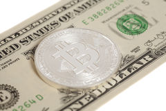 Silver bitcoin coin and one  dollar banknote Royalty Free Stock Images