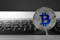 Silver bitcoin on computer keyboard. Digital currency. Silver bitcoin on computer keyboard, space for text. Digital currency stock photos