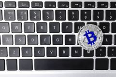 Silver bitcoin on computer keyboard. Space for text. Silver bitcoin on computer keyboard, top view. Space for text stock photos