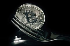 Silver bitcoin with fork. Hard fork change concept. Currency of the future Royalty Free Stock Photos
