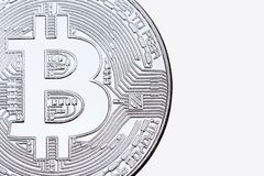 Silver bitcoin isolated on white background close-up. stock photos