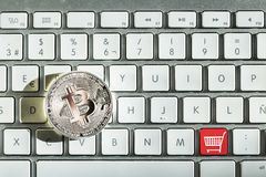 Silver bitcoin in keyboard. And symbol of buy stock photo