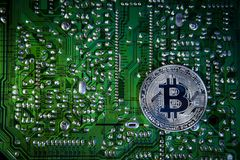 Silver Bitcoins on the chip. The green background. Crypt Of Safety Royalty Free Stock Images