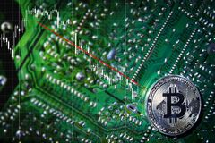 Silver Bitcoins on the chip. Trend down. The green background. Crypt Of Safety Stock Photo