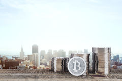 Silver bitcoins with city view Royalty Free Stock Images