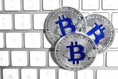 Silver bitcoins on computer keyboard, flat lay. Space for text stock photo
