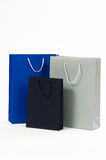 Silver, black and blue paper bag on a white background Royalty Free Stock Image