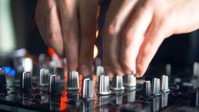 Silver and black mixer knobs in use. stock video footage