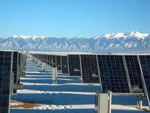 Silver and Black Solar Panels on Snow Covered Ground Stock Photo