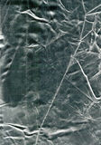 Silver blend texture. Shiny and crumpled material Stock Photos