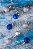 Silver and blue christmas ball on the wooden table, selective fo Royalty Free Stock Photo