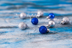 Silver and blue christmas ball on the wooden table, selective fo Stock Images