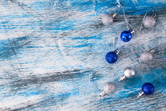 Silver and blue christmas ball on the wooden table, selective fo Stock Image