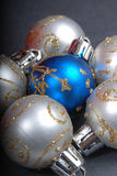 Silver & blue Christmas balls. A closeup view of several silver and a blue Christmas balls or ornaments stock image