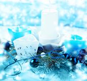 The Silver and blue Christmas balls and gifts on cool glitter lighting background stock photography