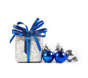 Silver and blue Christmas balls and gifts on white background. The Silver and blue Christmas balls and gifts on white background royalty free stock photos