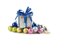 Silver and blue Christmas balls and gifts on white background stock image