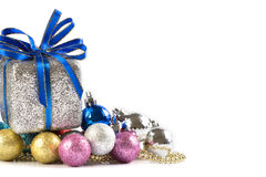 Silver and blue Christmas balls and gifts on white background royalty free stock image