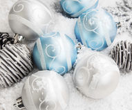 Silver and Blue Christmas Balls in the Snow. With Cones, Winter Holiday Decoration Royalty Free Stock Photography