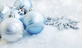 Silver and Blue Christmas Balls with Sparkle and Snow. Silver and Blue Christmas Balls with Sparkle Snowflakes and Snow Stock Photography