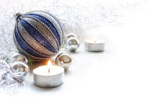 Silver and blue christmas decoration with baubles and candles Royalty Free Stock Images