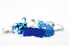 Silver and blue christmas decoration on snow with wishes card stock photos