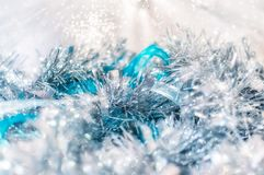 Magical fairy background for Christmas. Silver and blue Christmas decorations with selective focus on an abstract bokeh fairy lights blurred background Royalty Free Stock Image