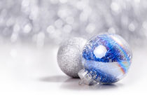 Silver and Blue Christmas ornaments balls on glitter bokeh background with space for text. Xmas and Happy New Year Royalty Free Stock Images