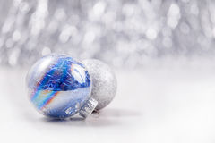 Silver and Blue Christmas ornaments balls on glitter bokeh background with space for text. Xmas and Happy New Year Stock Photos