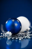 Silver and blue christmas ornaments on dark blue background. Merry christmas card. Royalty Free Stock Photos