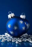 Silver and blue christmas ornaments on dark blue background with space for text Royalty Free Stock Photos