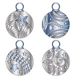 Silver and blue festive Christmas baubles. With stripes and stars Stock Images