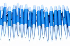Silver-blue metal pens isolated on white background. Stock Images