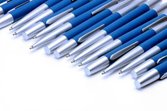 Silver-blue metal pens isolated on white background. Stock Photo