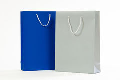 Silver and blue paper bag on a white background Stock Photos
