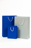 Silver and blue paper bag on a white background Royalty Free Stock Photography