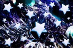 Silver blue stars on needles sprig blurred abstract background Stock Photos