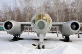 Silver bomber plane. This is old bomber plane IL 28. The old fashioned military plane on withe snow.The first flight took place in 1948. The first jet bomber Stock Image