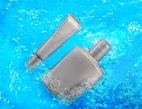 Silver bottles of shampoo Stock Photos