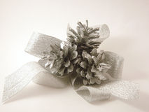 Christmas cones and ribbon Royalty Free Stock Photos