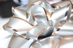 Silver bow. Close up shot of silver bow Royalty Free Stock Images