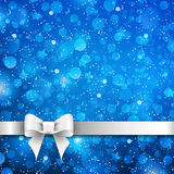 Silver bow on blue background Stock Image